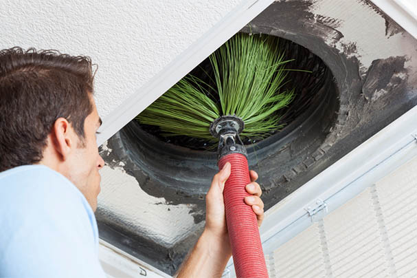 Torrance air duct cleaning company employees at work cleaning duct dryer vent